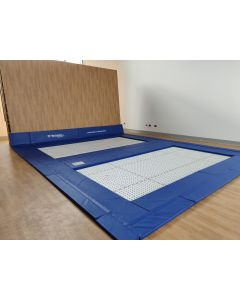 Folding floor pit system for rebound therapy trampolines